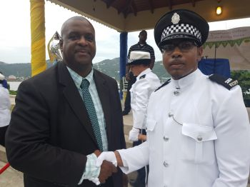 "Police Constable Deonarine ""Deo"" Persaud in a Photo opportunity with leader of the Opposition, Hon Andrew A. Fahie (R1) who challenged the new batch of police officers to be fair, firm and friendly. Photo: VINO"