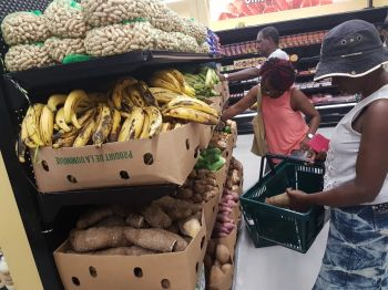 Customers shopping in the store's provision section. Photo: VINO