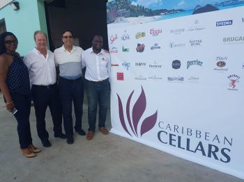 """Also on hand for the grand reopening was President of Caribbean Cellars Richard Berry who said he was """"Proud of the reopening and to partner with the building owners, the O'Neal family"""". Photo: VINO"""