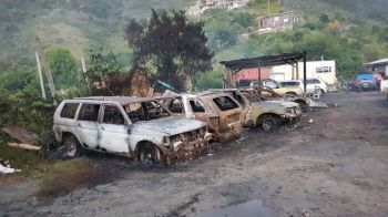 What remains of the burnt vehicles. Photo: Team of Reporters