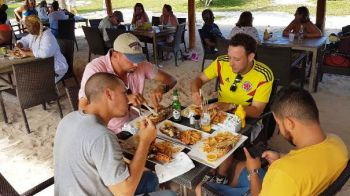 Hopping from point to point was the spice of Anegada's Lobster Fest where revellers feasted, feted and socialized at the popular spots. Photo: Team of Reporters