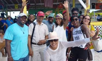 From L-R, Minister for Health and Social Development, Honourable Marlon A. Penn, Premier and Minister of Finance Dr the Honourable D. Orlando Smith (AL) and Mrs Lorna G. Smith with friends at Anegada Lobster Fest yesterday, November 25, 2018. Photo: Team of Reporters