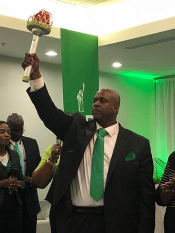 Hon Fahie holding the Torch. Photo: Team of Reporters