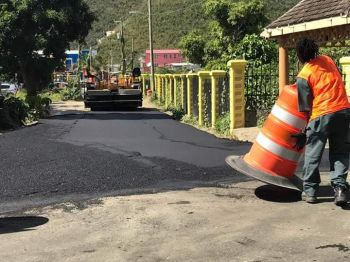 Construction cones being placed on a road in the Purcell Estate area after some seven and a half years of no action. Photo: Team of Reporters