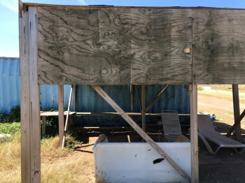 Workers were able to get someone to donate some plywood to build a makeshift shack, however, there is no restroom, kitchen, proper work stations and the plywood station is not conducive even for animals. Photo: VINO
