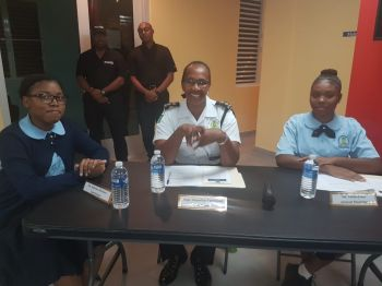 The night's activity saw a blend of police and civilians with senior students of the Elmore Stoutt High School (ESHS) moderating with Superintendent of Police Jacqueline E. Vanterpool and ESHS's Talisha Jones while the timekeeper was also an ESHS student. Photo: VINO