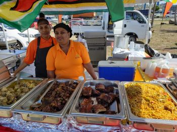 International food tent featuring foods from Guyana. Photo: VINO