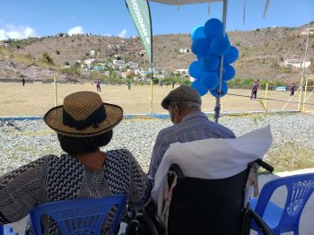 Hon O'Neal taking in the game between the Virgin Gorda Spartans and the Cavaliers at the Greenland Recreation Ground after receiving his plaque of honour. Photo: VINO