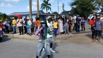 Despite the reduction in size many persons from across the territory and tourist from around the world lined the route to cheer the revelers on. Photo: VINO