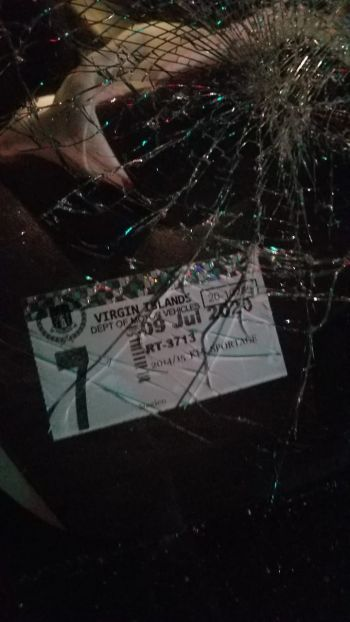 A damaged window on the rental SUV that came as a result of the accident. Photo: Team of Reporters