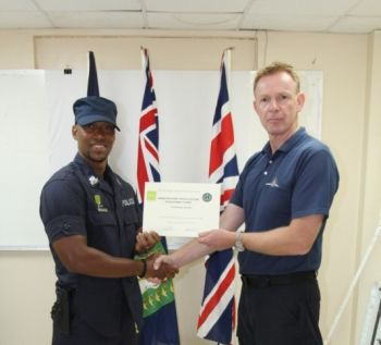 Constable Vic-Kaycee M. G. Winter receiving one of his many certificates in Police Training. Photo: Provided