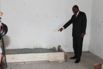 Minister for Communications and Works Hon. Mark H. Vanterpool during his recent visit to the Old HM Prison on Main Street, Road Town. Here he is seen in the room where the last hanging at the prison took place in 1974. The execution area is well in tact with the wooden floor where it was reported that the prisoners would fall through following the execution. Photo: VINO