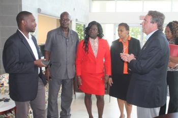 Director of Transport for MASA Mr Dusty Cook (right) speaking with other officials including MASA agent Warren D. Wintz (left). Photo: VINO