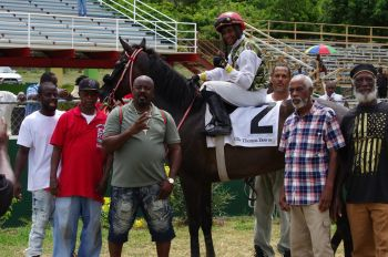Artra By Me of St Thomas in the Winner's Circle after blazing to victory in the opening race, over 7 furlongs for Class C&D Mares and Fillies for a purse of $6000.00 at Ellis Thomas Downs on July 7, 2019. Photo: VINO